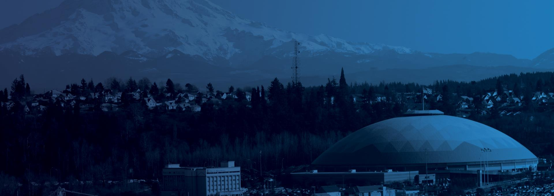 A view of the Tacoma Dome with Mt. Rainier in the background.