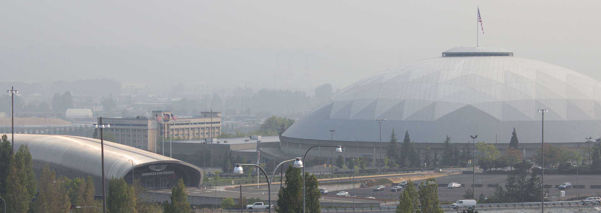 View of Tacoma Dome and skyline with wildfire smoke in the air.