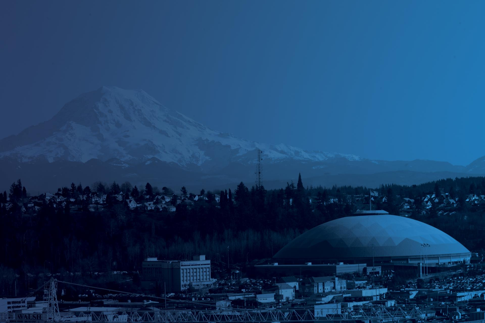 View of Mt. Rainier and the Tacoma Dome with a blue color overlay.
