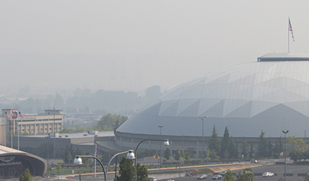 View of the Tacoma Dome and city skyline with hazy skies from wildfire smoke.