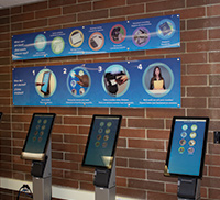 Vital Records Office with self-serve kiosks and instructional signage.