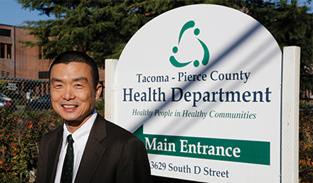 Tacoma-Pierce County Health Department Director of Health Anthony L-T Chen, MD, MPH, in front of a Health Department Sign
