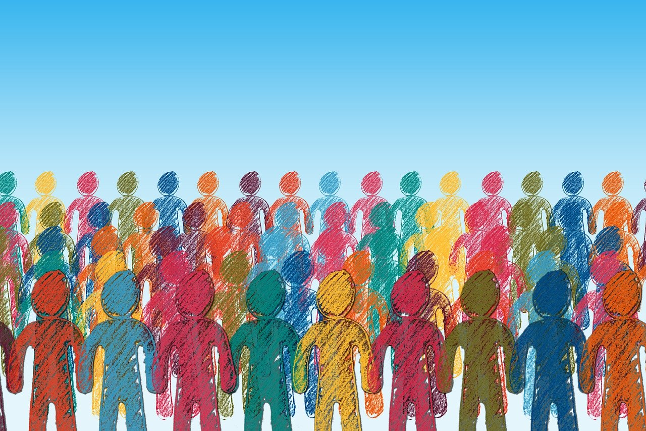 An illustration of a crowd of people of different colors holding hands.